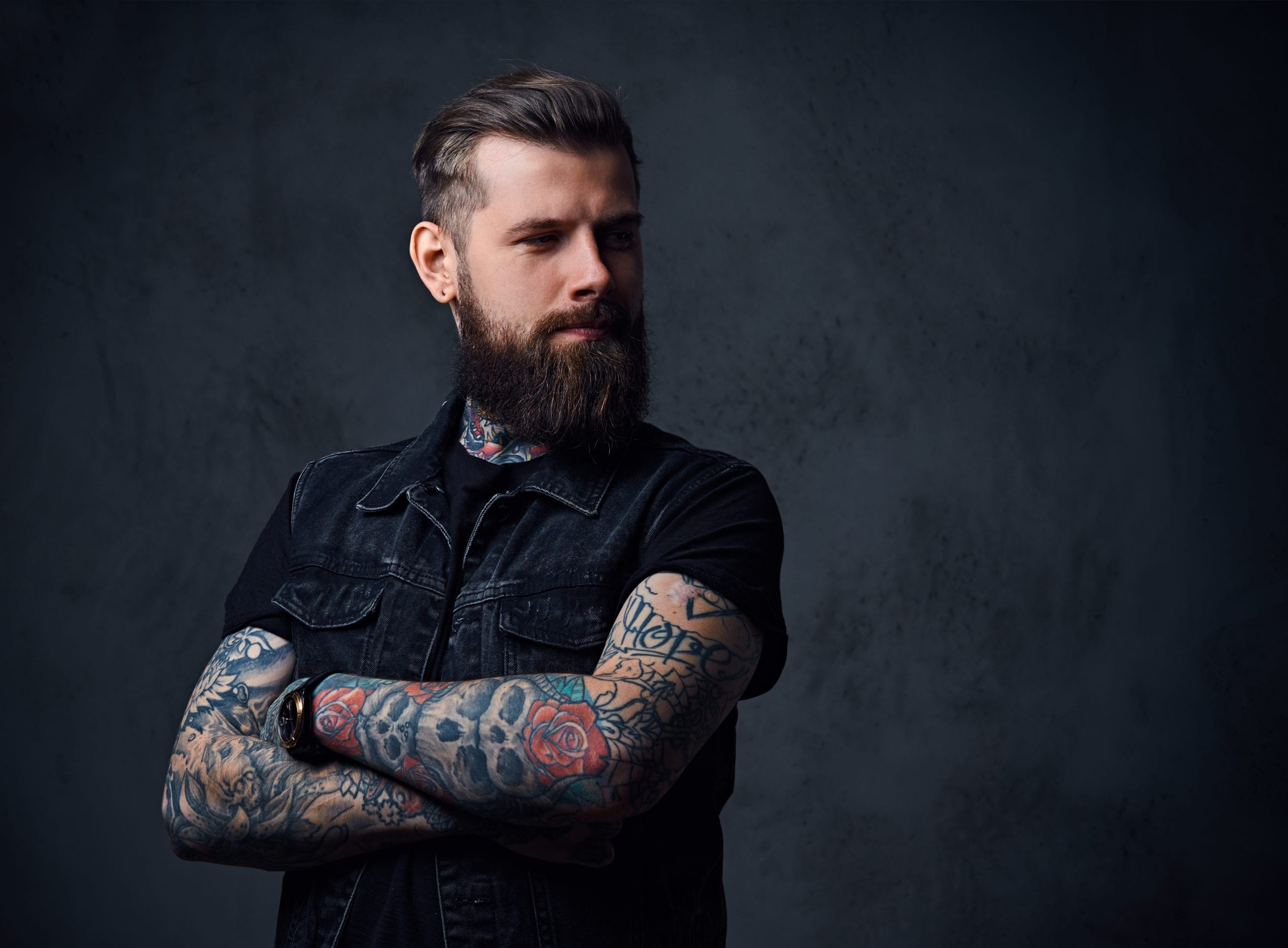 tattooed man with arms crossed